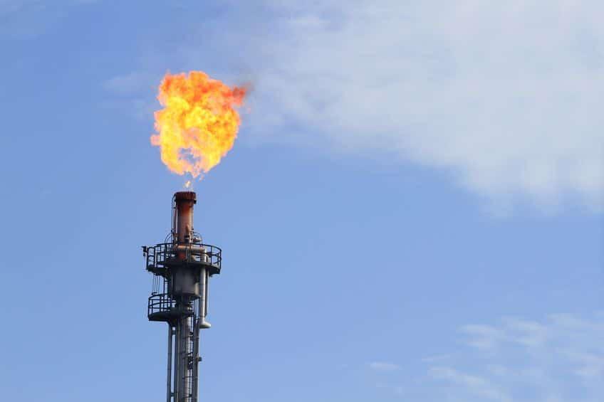 14752473 - burning oil flare on a blue sky